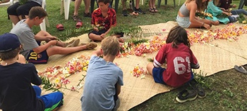 pacific island institute people with flowers lei