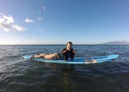 maui surf lessons TeenGirlsideDoubleShakalayingonboard